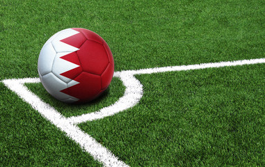 soccer ball on a green field, flag of Bahrain