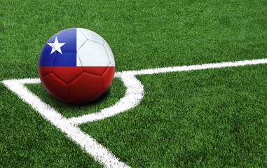 soccer ball on a green field, flag of Chile