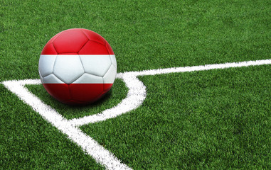 soccer ball on a green field, flag of Austria
