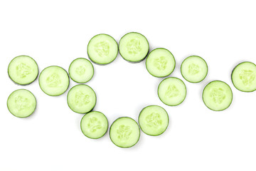 Cucumber slices in circle on white background with copyspace