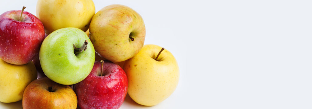 Natural, organic apple fruit. Difference concept. Various fresh ripe apples in different colors: red, yellow, green, orange. macro view. white background, copy space
