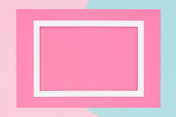 Abstract geometrical pastel blue, teal and pink paper flat lay background. Minimalism, geometry and symmetry template with empty picture frame mock up.