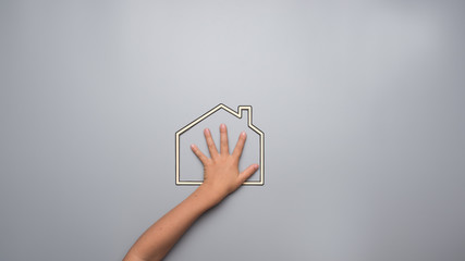 Child indicating his love for his home in a conceptual image