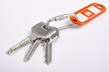 Key ring with keys over white background. Rent