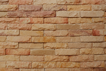 Natural sandstone brick wall background