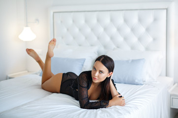 Perfect woman in a black sexy lingerie
