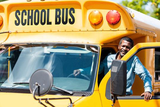 handsome senior school bus driver looking at camera