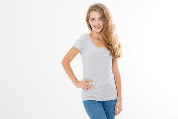 Young blonde woman with fit slim body in blank template t shirt and jeans isolated on white background. Skin and hair care. Copy space and mock up