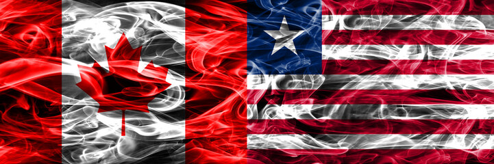 Canada vs Liberia smoke flags placed side by side. Canadian and Liberia flag together