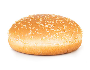 Burger bun with sesame seeds isolated on white background.