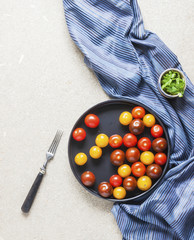Cherry tomatoes of different colors and other ingredients for diet salad. Proper diet. Top view. Healthy lifestyle.