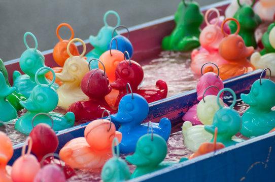 closeup of plastic rubber ducks fishing at the fun fair