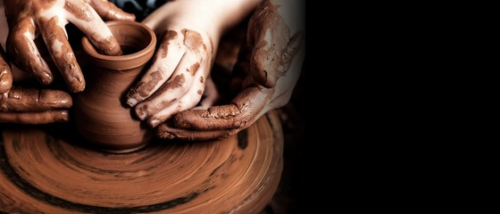 Hands of potter making clay pot, closeup photo Fototapete