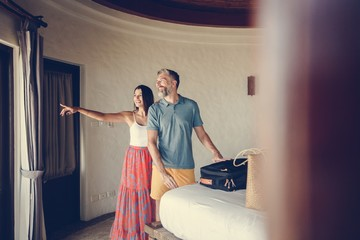 Honeymooners checking in to a hotel room