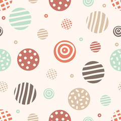Seamless pattern with hand drawn colorful polka dots on texture background.