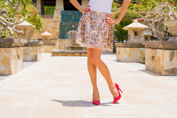 Woman wearing skirt and red high heels