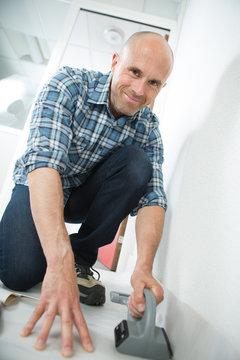 handyman flooring in home construction site