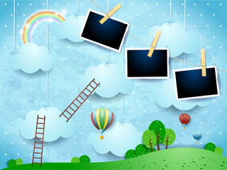 Surreal landscape with ladders, balloons and photo frames