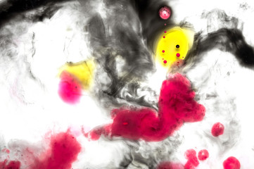 Abstract ink background. Moving liquid paint in water. Black thin circle with yellow and pink dot
