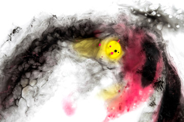 Abstract ink background. Moving liquid paint in water. Yellow and magenta color mix i black ink shape