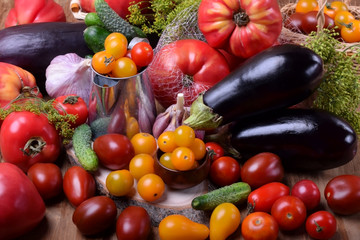 Varying sorts of tomatoes and other vegetables. Freshly picked harvest
