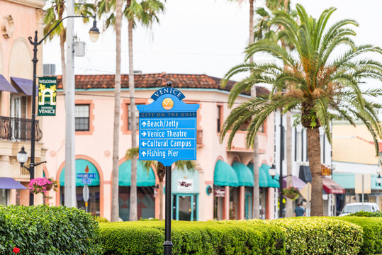 Sign in Venice, small Florida retirement city, town, or village with colorful architecture, in gulf of Mexico, palm trees on street