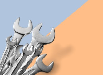 Metal wrench tools on background