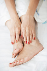 Feet and hands of woman