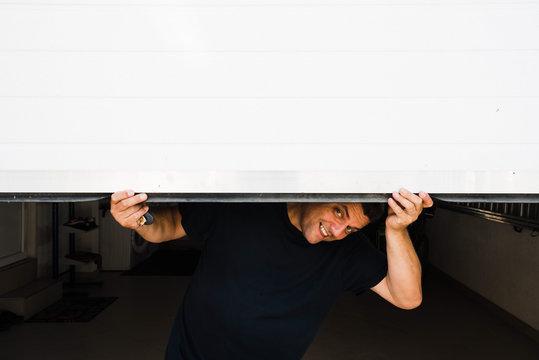 man with hands holds pvc garage door