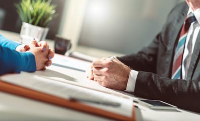 Business negotiation between businesswoman and businessman, light effect
