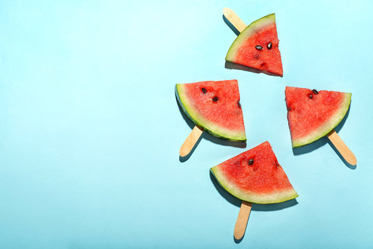 Delicious sliced watermelon on color background