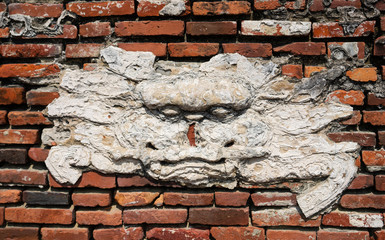 Old remains of a sword lion on a brick wall in Anping Tainan Taiwan