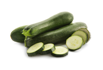 Fresh zucchinis on white background