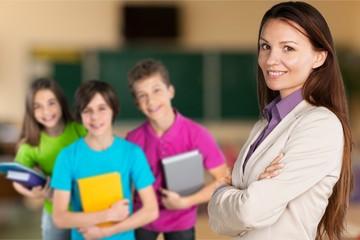 Female teacher with children at class
