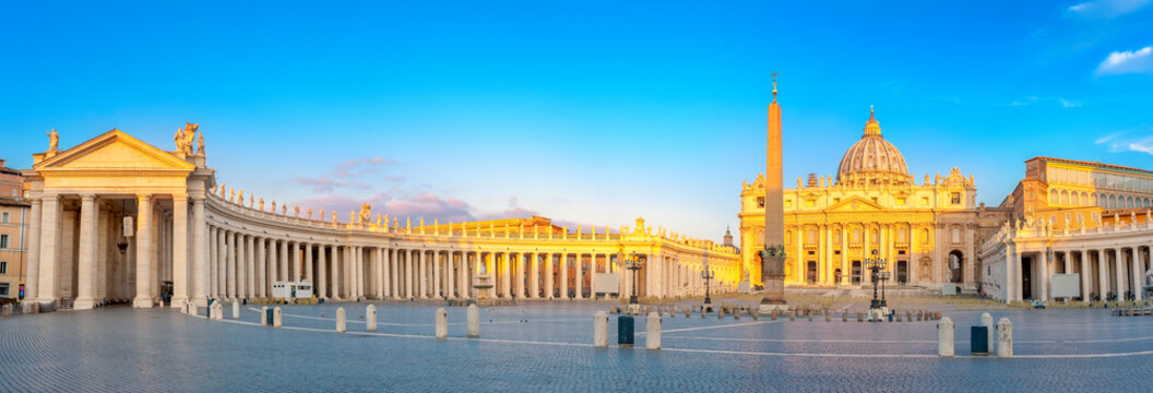 Panorama of St. Peter's Square illuminated by the first rays of the morning sun, the Vatican. Italy