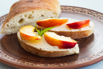 Sandwiches with cream cheese and fruit. Breakfast. Homemade bread and sandwiches with cream cheese.