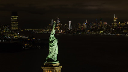 Aerial night image of the Statue of LIberty New York City