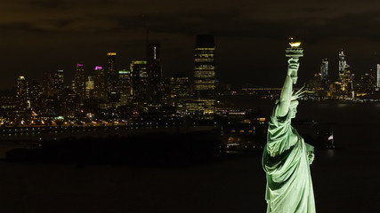 Statue of LIberty night aerial with city view background