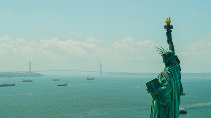 Aerial image of the Statue of LIberty overlooking the harbor