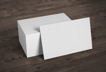 Blank template mockup business cards on wooden background. 3D rendering.