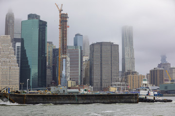 Image of New York City with a passing barge
