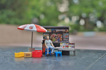 a  small figure of small store at outdoor