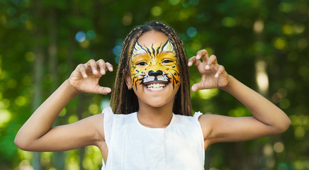 Little black girl with tiger face painting