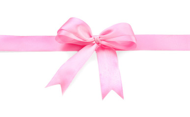 Pink ribbon with bow on white background