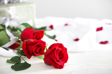 Beautiful red roses on white table