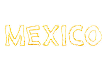 The word MEXICO made with pieces of fried French fries isolate on a white background