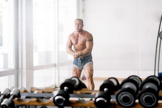 Muscular older man posing