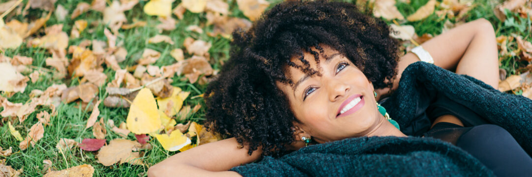 Afro hair style woman daydraming in autumn