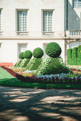 French traditional building with classical garden with geometrical forms. French architecture concept