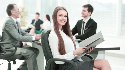 Executive business woman with clipboard modern office